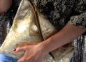 Gold calfskin clutch